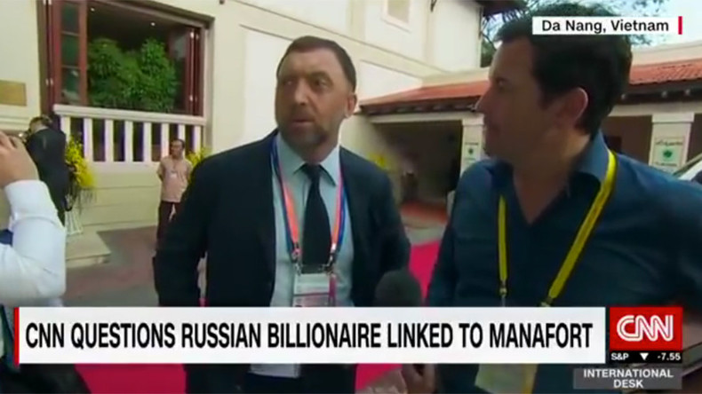 'Get lost please': Moment Russian tycoon brushes off CNN reporter caught on camera