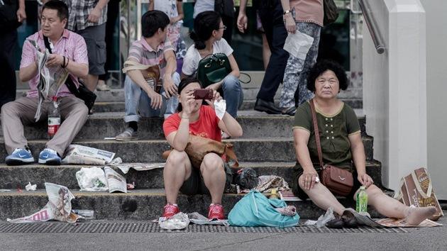 """Guía de """"turismo civilizado"""" para chinos: """"No se lleven los salvavidas de los aviones"""""""