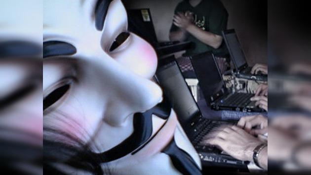 Detienen a tres hackers de la red Anonymous en España