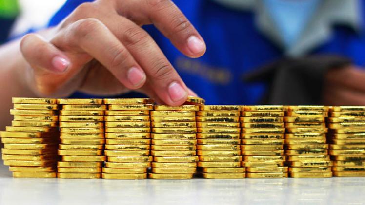 Subida del precio del oro, ¿escudo contra el dólar y euro débiles?