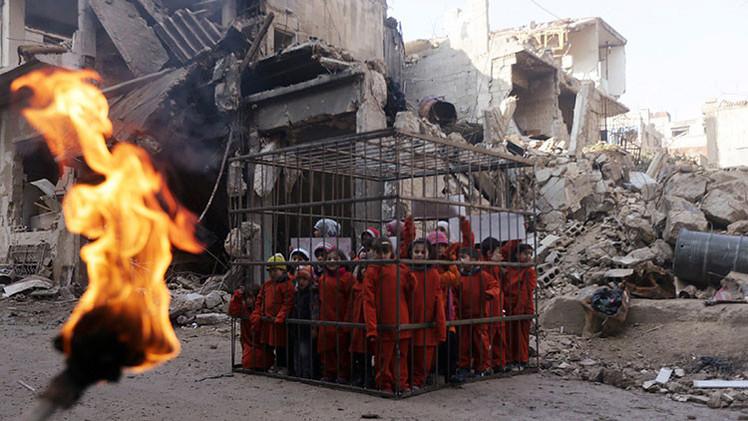 Video: Niños sirios enjaulados protagonizan una polémica protesta