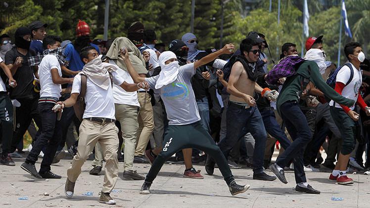 La muerte de cuatro activistas recrudece la protesta juvenil en Honduras
