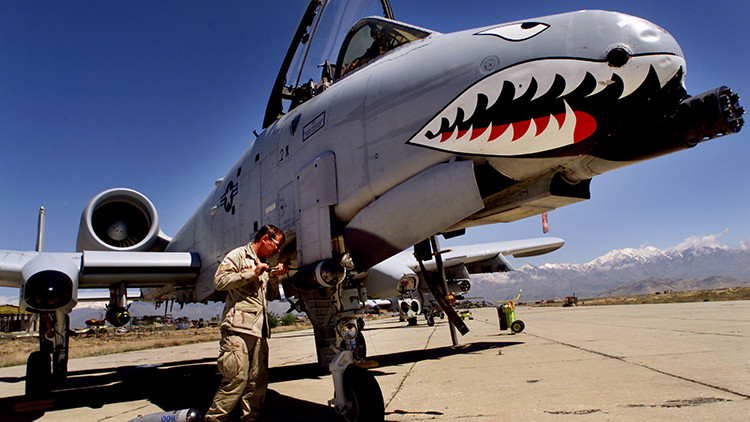 Staff Sergeant Keith Haas of the US Air Force adjusts equipment on a A-10 Warthog warplane at Bagram