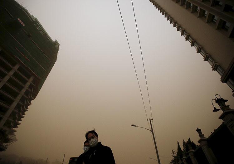 Fotos insólitas: Pekín engullido por la más fuerte tormenta en los últimos 13 años