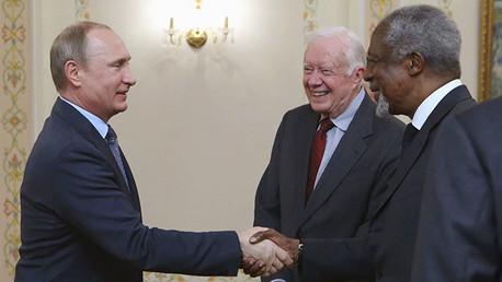 Jimmy Carter en una reunión con Vladímir Putin