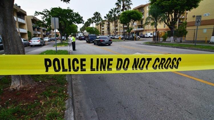 Un policía de Miami mata a tiros a un negro sintecho delante de decenas de niños