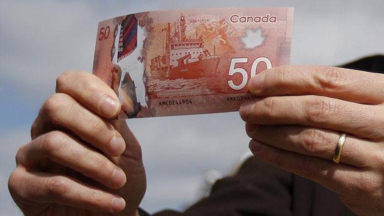 ¿Para qué los canadienses parten billetes por la mitad?