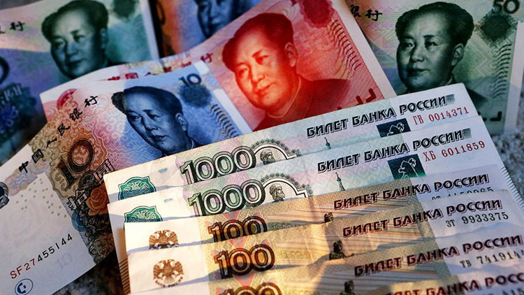 Rusia y China expulsan al dólar del comercio global