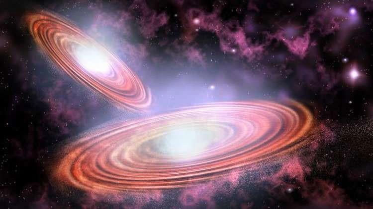 El choque de dos agujeros negros supermasivos generará una potente explosión