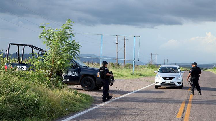 Fotos: La 'cacería' de 'El Chapo' deja un rastro de coches y casas baleadas en el Triángulo Dorado