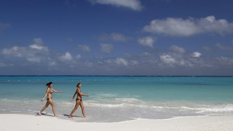Turistas en la ciudad de Cancún
