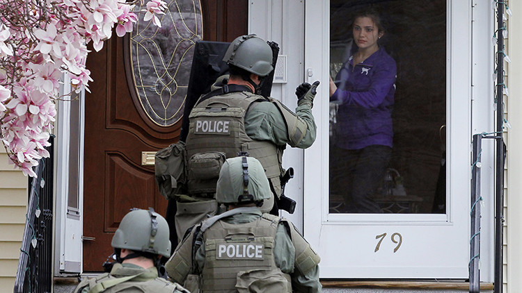 DATE IMPORTED:April 19, 2013A member of the SWAT team motions to a resident to come out of the house as they conduct a house to house search for Dzhokar Tsarnaev, the one remaining suspect in the Boston Marathon bombing, in Watertown, Massachusetts April 19, 2013.