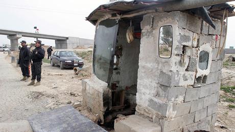Las fuerzas de seguridad de Irak en un punto de control en Taza, Irak