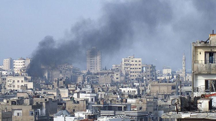 Siria: Al menos 12 muertos por dos ataques suicidas en Homs (fotos)