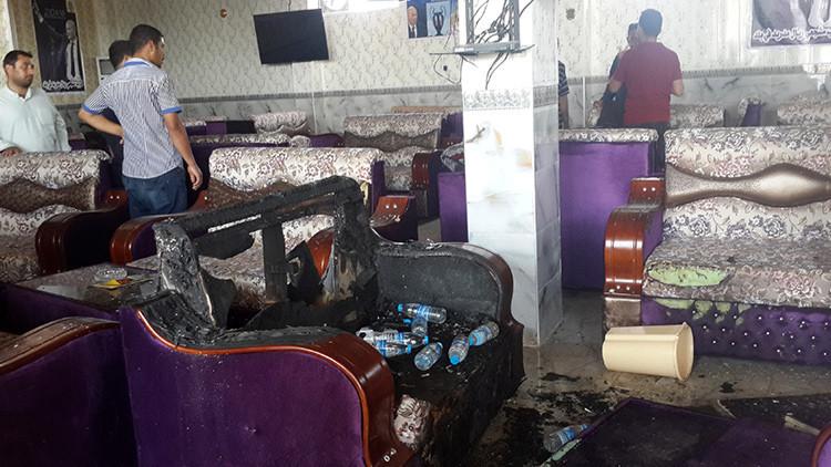 16 muertos en un atentado en un bar de hinchas del Real Madrid en Irak (FUERTES IMÁGENES)