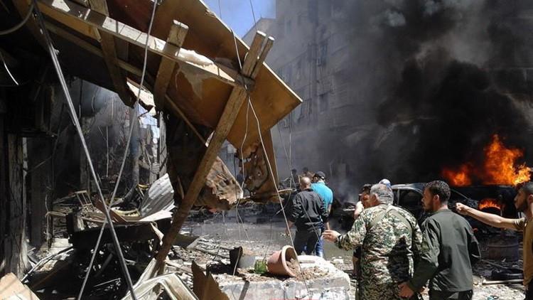Un barrio de la ciudad siria de Sayeda Zaynab dañado por las explosiones