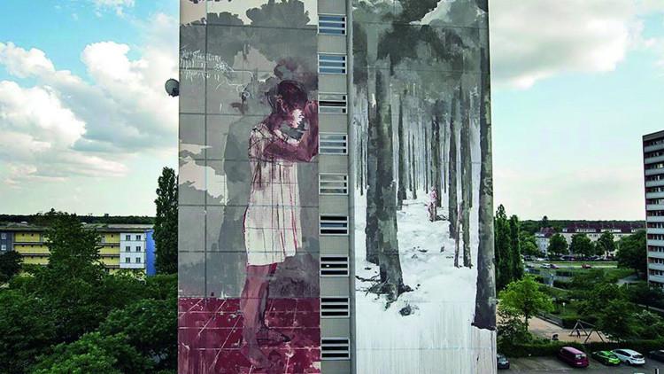 Polémica en Berlín por mural de un pintor español con una niña refugiada ensangrentada (foto)