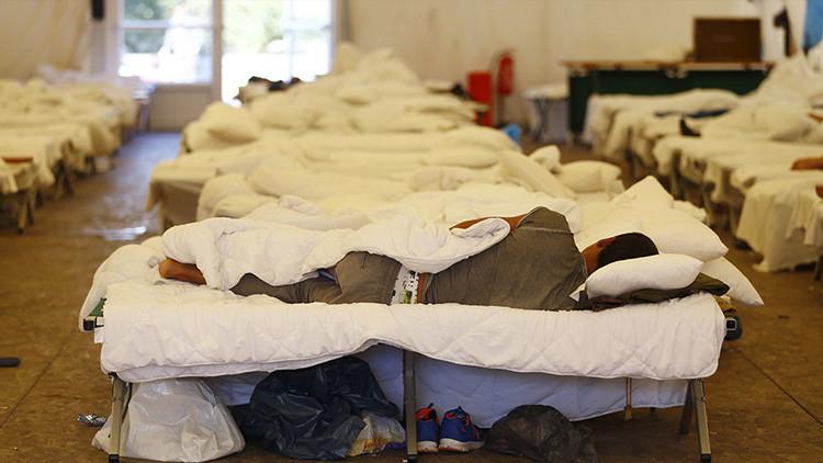 Turista chino es víctima de un atraco en Alemania y termina en un campo de refugiados por error