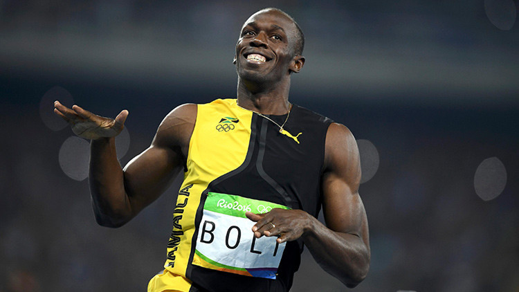 """""""Iba a toda marcha, sonriendo"""": la historia de la foto que plasma la superioridad de Usain Bolt"""