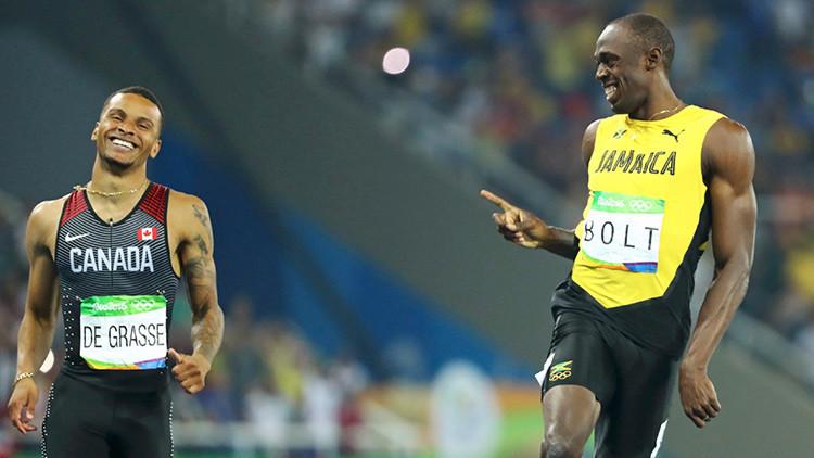 Usain Bolt intercambia sonrisas con su rival durante la semifinal de los 200 metros (fotos)