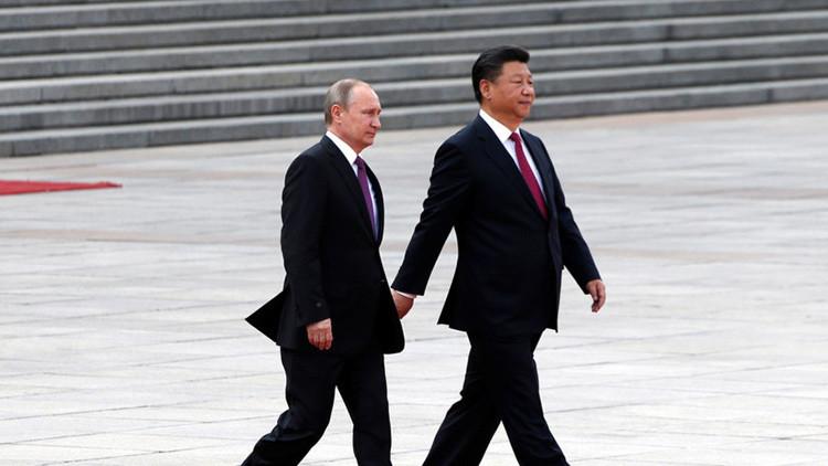 Vladímir Putin, presidente de Rusia, y Xi Jinping, presidente de China.
