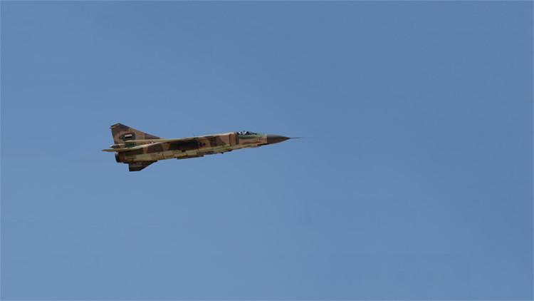 Un MiG-23 de la Fuerza Aérea siria durante una misión cerca de la localidad de Al-Qaryatayn, en la provincia de Homs.