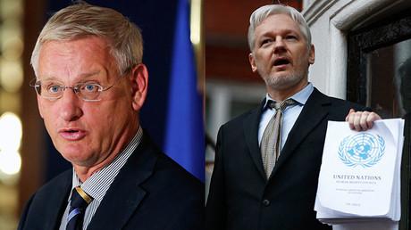 El ex primer ministro sueco, Carl Bildt (izquierda), y el fundador de WikiLeaks, Julian Assange.