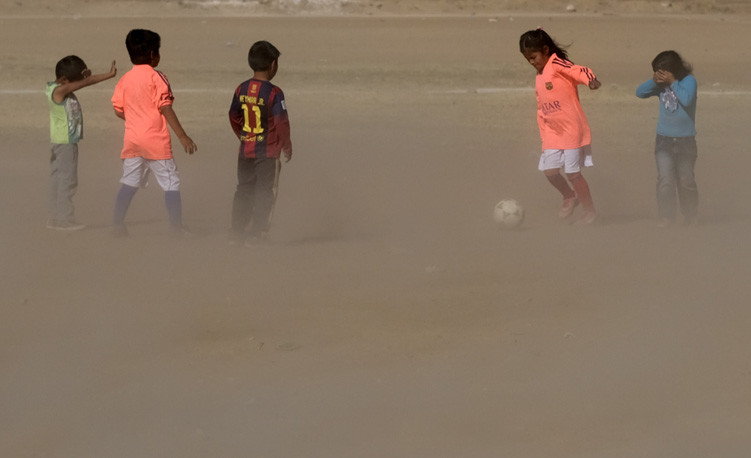 Children play soccer on a dusty field where rain has been scarce in one of the worst droughts in the past 30 years, according to the Bolivian government and aid agencies, in Cochabamba, Bolivia
