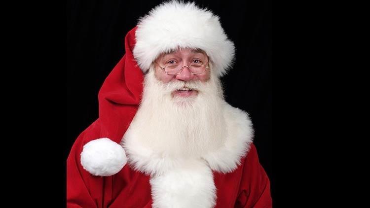 Santa Claus cumple el último deseo de un niño enfermo que muere en sus manos