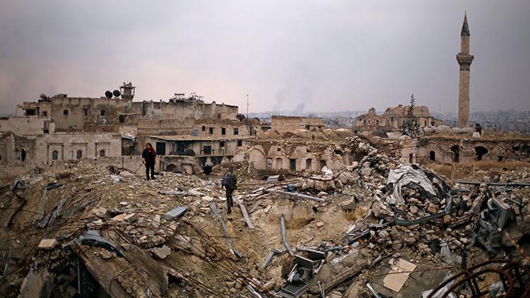 """La liberación de Alepo """"hace historia"""", Obama amenaza a Rusia por los 'hackeos' y China caza un dron"""