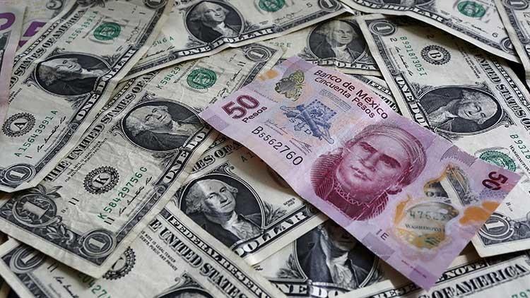 El peso mexicano alcanza un nuevo mínimo histórico de 22 unidades por dólar
