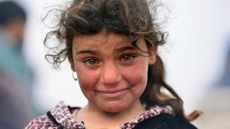 Fotos desgarradoras: Niños muertos, la carga amarga de los desplazados de Mosul