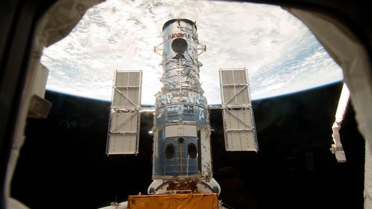 El telescopio espacial Hubble capta una galaxia 'suicida' que se devora a sí misma (FOTO)