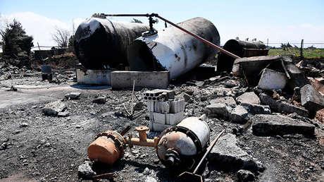 Las consecuencias del ataque estadounidense contra una base aérea en Siria.