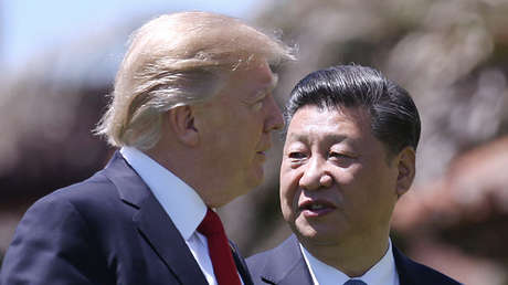 El presidente de Estados Unidos Donald Trump con su par chino Xi Jinping