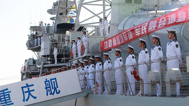 China está armando con misiles una base militar en el mar en disputa, según imágenes de satélite