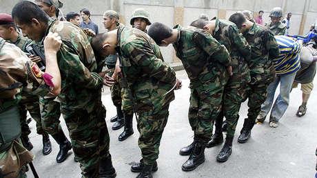 Paramilitares colombianos capturados en una finca cercana a Caracas en  2004