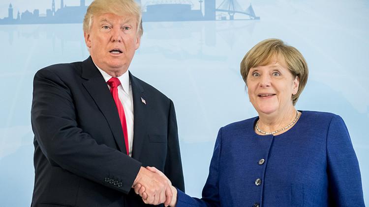 Por fin: Merkel y Trump se dan un apretón de manos en vísperas de la cumbre del G20 (VIDEO)