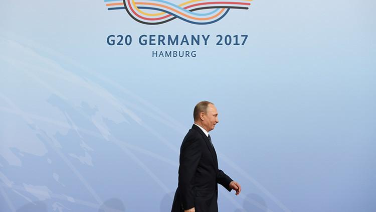 """""""¿Era Putin?"""": El despiste de una azafata de la cumbre del G20 con el presidente ruso (Video)"""