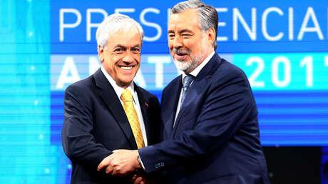 Los candidatos Sebastian Piñera y Alejandro Guillier en un debate televisivo.