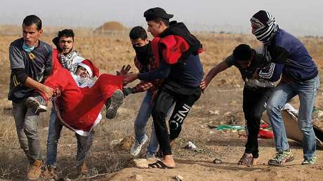 Manifestante palestino herido en las protestas contra el reconocimiento de Jerusalén como capital israelí / Franja de Gaza / 22 de diciembre de 2017.