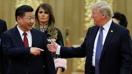 El presidente de EE.UU., Donald Trump, y su homólogo chino, Xi Jinping, en Pekín, China, el 9 de noviembre de 2017.