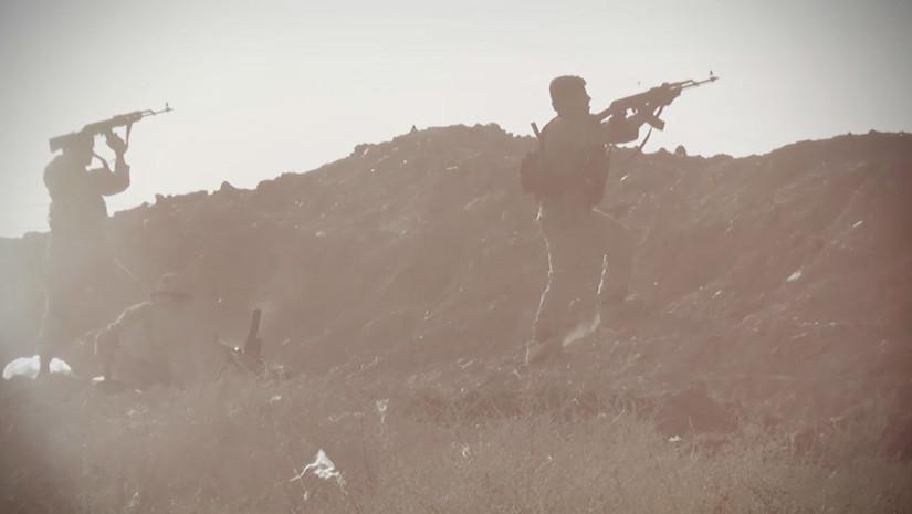 Milicianos del EI en la captura de pantalla de un video de propaganda del grupo terrorista.