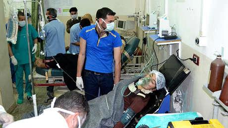 Una mujer siria afectada por un supuesto ataque con gas en Telminnes, el 21 de abril de 2014.