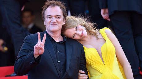 El director Quentin Tarantino y la actriz Uma Thurman posan en el 67 Festival de Cannes. Francia, 23 de mayo de 2014.