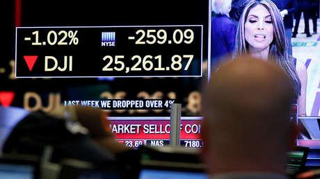 Una pantalla que muestra el índice Dow Jones Industrial Average en la Bolsa de Nueva York, el 5 de febrero de 2018.