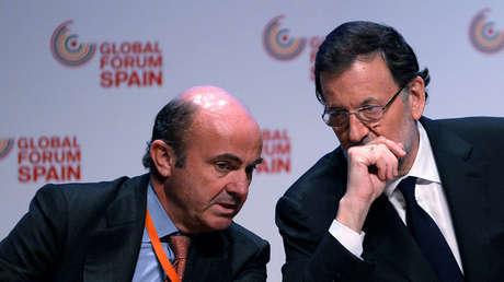 Luis de Guindos y Mariano Rajoy, ministro de Economía y presidente de España, Bilbao, 3 de marzo de 2014.