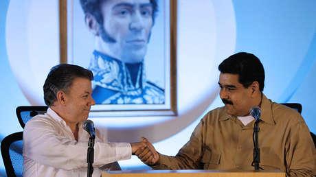 El presidente de Colombia, Juan Manuel Santos, y su homólogo venezolano, Nicolás Maduro