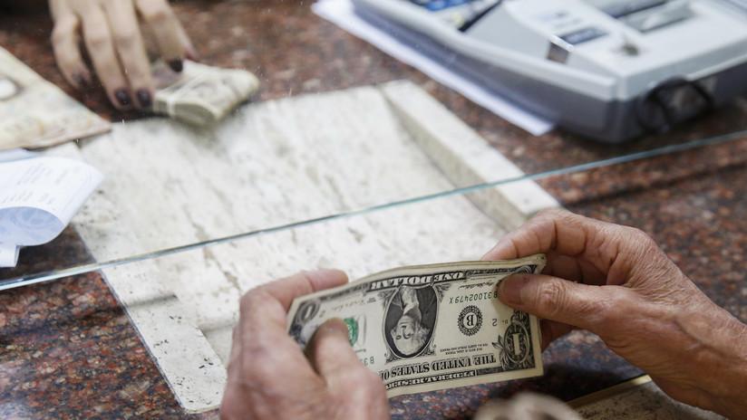 Venezuela: Detienen al responsable de una página que tasa el dólar ilegal