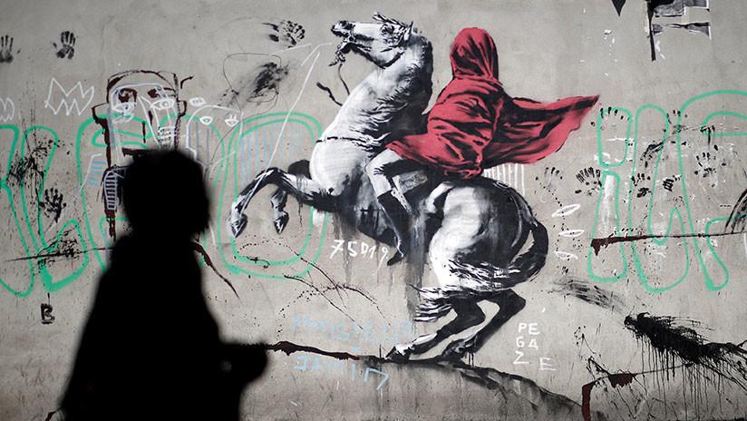 FOTOS: Banksy cubre muros en París con sus grafitis sobre la migración